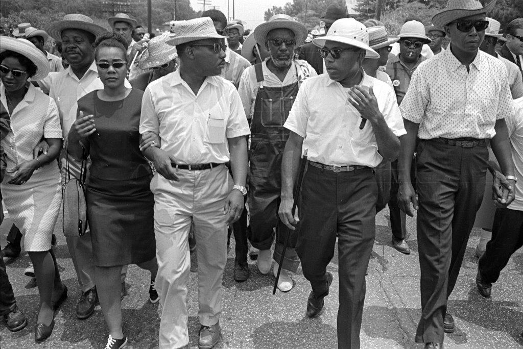 """Martin Luther King Jr. and James Meredith (top photo) walk side-by-side during the 1966 March Against Fear in Jackson. The photo is included in the """"James Meredith: Am I Or Am I Not a Citizen"""" exhibition at the Smith Robertson Museum and Cultural Center. The photo is from Bob Fitch Photography Archives and Stanford University Libraries. COURTESY USE FROM SMITH ROBERTSON MUSEUM"""