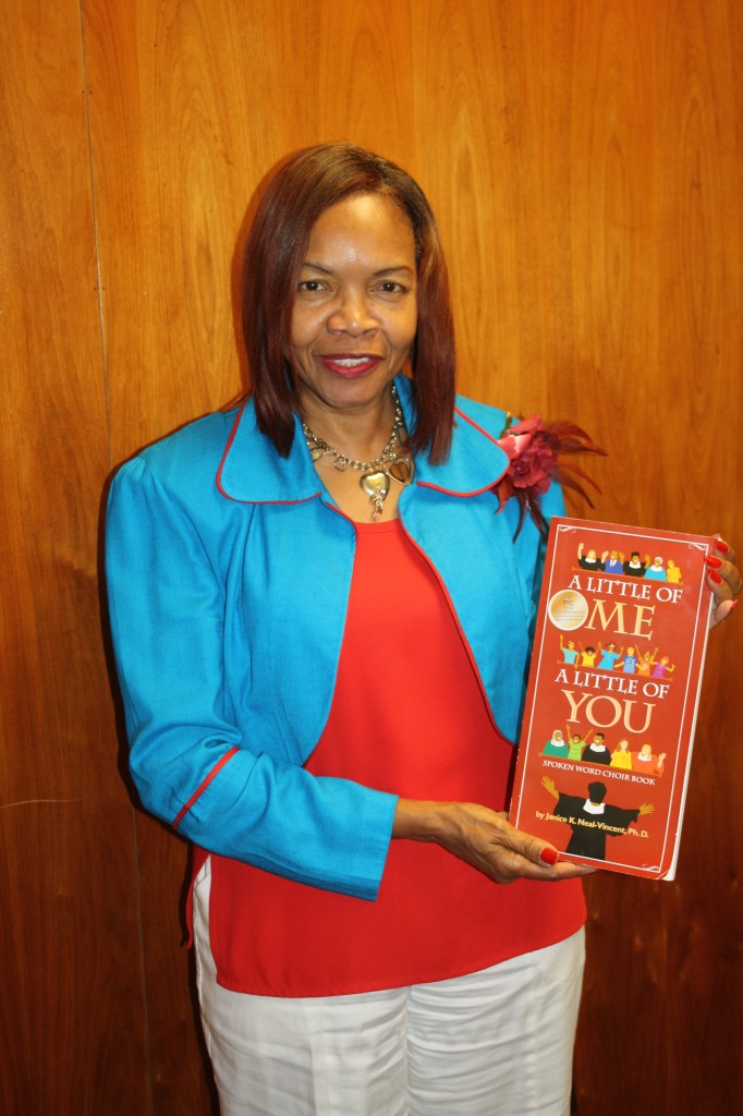 """Janice K. Neal-Vincent holds her new book titled """"A Little of Me: A Little of You."""""""