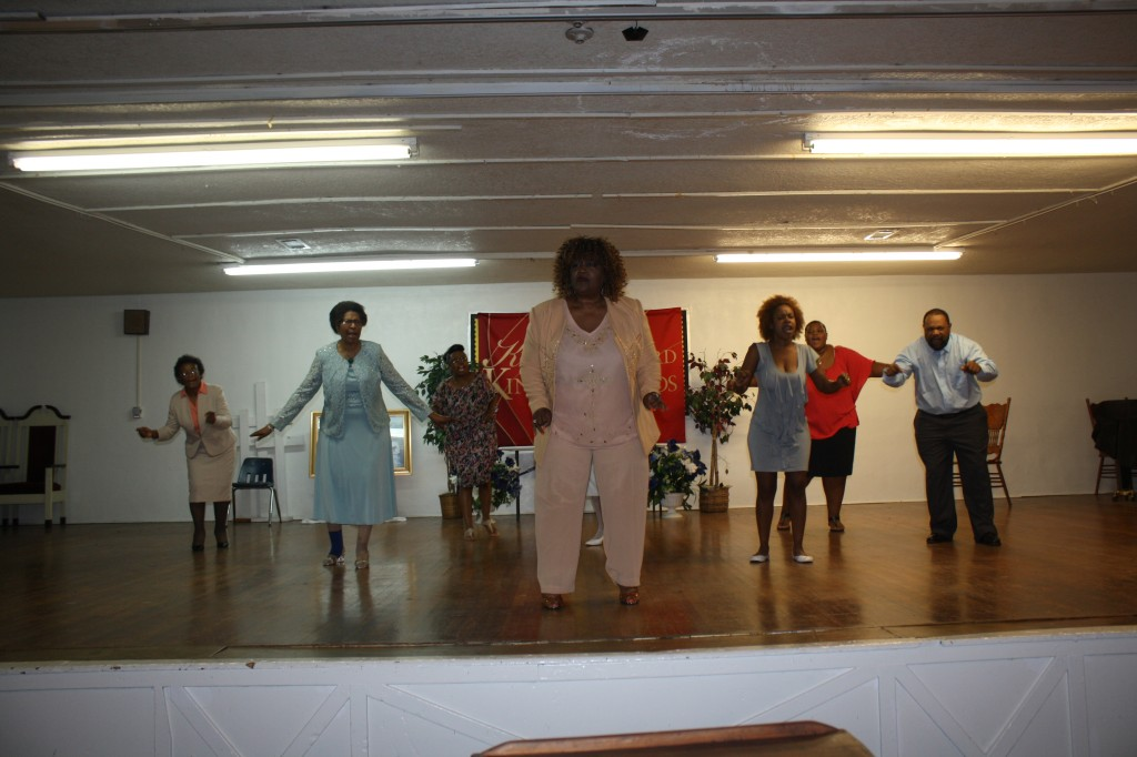 Dr. Toni Roberts (center) leads the spoken word choir in 'Breakaway: Loose These Chains of Bondage' during their rehearsal. Other choir members are (L to R) Doretha Wiley, Ann Sanders, Zimbabwe Mays, Eliza Robinson, Alyce Bouldin and Gino Bouldin. PHOTOs BY SHANDERIA K. POSEY