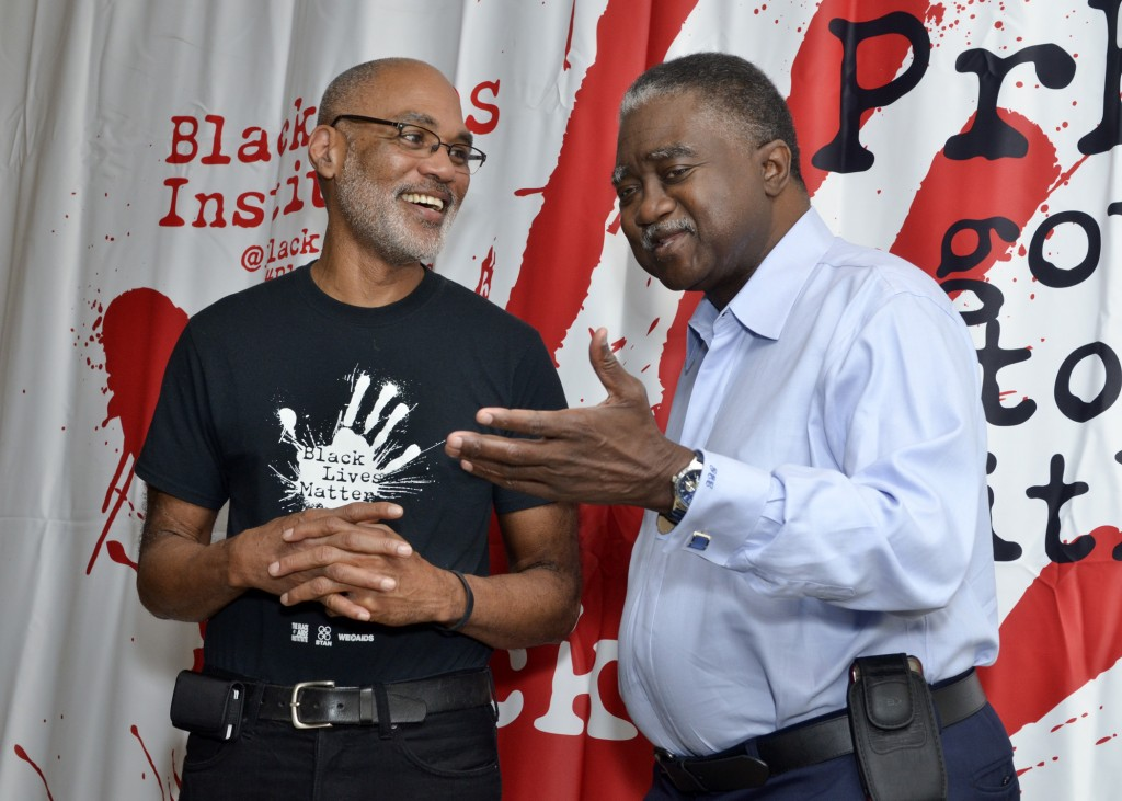 Phill Wilson (left), the president and CEO of the Black AIDS Institute, talks to George Curry at the 2016 International AIDS Conference in Durban, South Africa. Freddie Allen/AMG/BAI