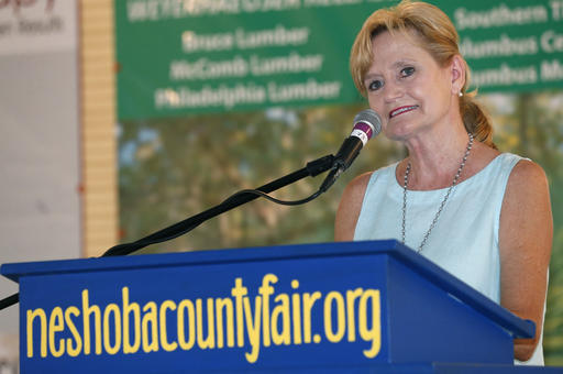 Republican Agriculture Commissioner Cindy Hyde-Smith, speaks about the improvements taking place at the state fairgrounds in Jackson, Miss., during her speech at Founders Square at the Neshoba County Fair, Thursday, July 28, 2016, in Philadelphia, Miss. The annual fair is a traditional gathering place for politicians, area residents, business leaders, voters and families. (Rogelio V. Solis/The Associated Press)