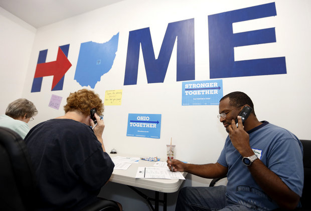 Phone volunteers Dy' Sheam West, right, of Jacksontown, Ohio, Terry Flash, center, of Buckeye Lake, Ohio, and Charlyn Rusk of Johnstown, Ohio, make calls seeking support for Hillary Clinton at the Ohio Together Hillary Clinton campaign office in Newark, Ohio, Thursday, Sept. 1, 2016. (AP Photo/Paul Vernon)
