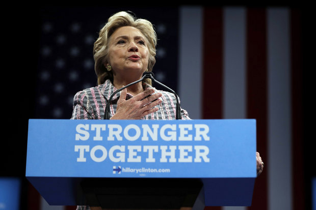"In this Sept. 30, 2016, photo, Democratic presidential candidate Hillary Clinton speaks during a campaign stop in Fort Pierce, Fla. Clinton told bankers behind closed doors that she favored ""open trade and open borders"" and said Wall Street executives were best-positioned to help reform the U.S. financial sector, according to transcripts of her private, paid speeches leaked Friday. (AP Photo/Matt Rourke)"
