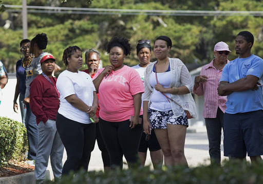 Members of the community gather before Derrick Johnson president of the Mississippi NAACP, speaks in front of the Stone County Courthouse in Wiggins, Miss., Monday, Oct. 24, 2016. Johnson is demanding a federal investigation after the parents of a black high school student said four white students put a noose around their son's neck at school. (AP Photo/Max Becherer)