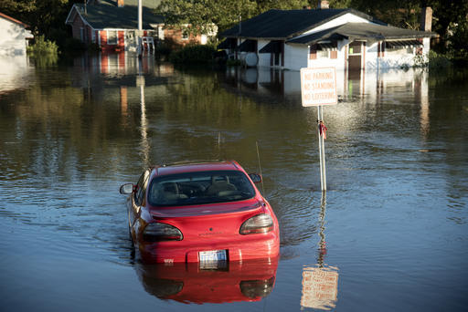 A car is submerged in floodwaters caused by rain from Hurricane Matthew in Lumberton, N.C., Monday, Oct. 10, 2016. (Mike Spencer/The Associated Press)