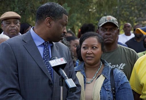 Derrick Johnson, left, president of the Mississippi NAACP, left, talks to Stacey Payton, center, with Hollis Payton, behind her, parents of a high school student, in front of the Stone County Courthouse in Wiggins, Miss., Monday, Oct. 24, 2016. Johnson is demanding a federal investigation after the parents said four white students put a noose around their son's neck at school. (Max Becherer/The Associated Press)