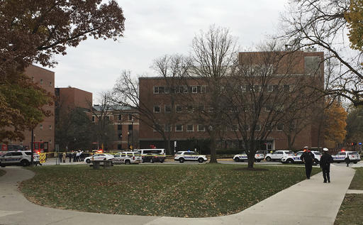 Police respond to reports of an active shooter on campus at Ohio State University on Monday, Nov. 28, 2016, in Columbus, Ohio. (Andrew Welsh-Huggins/The Associated Press)