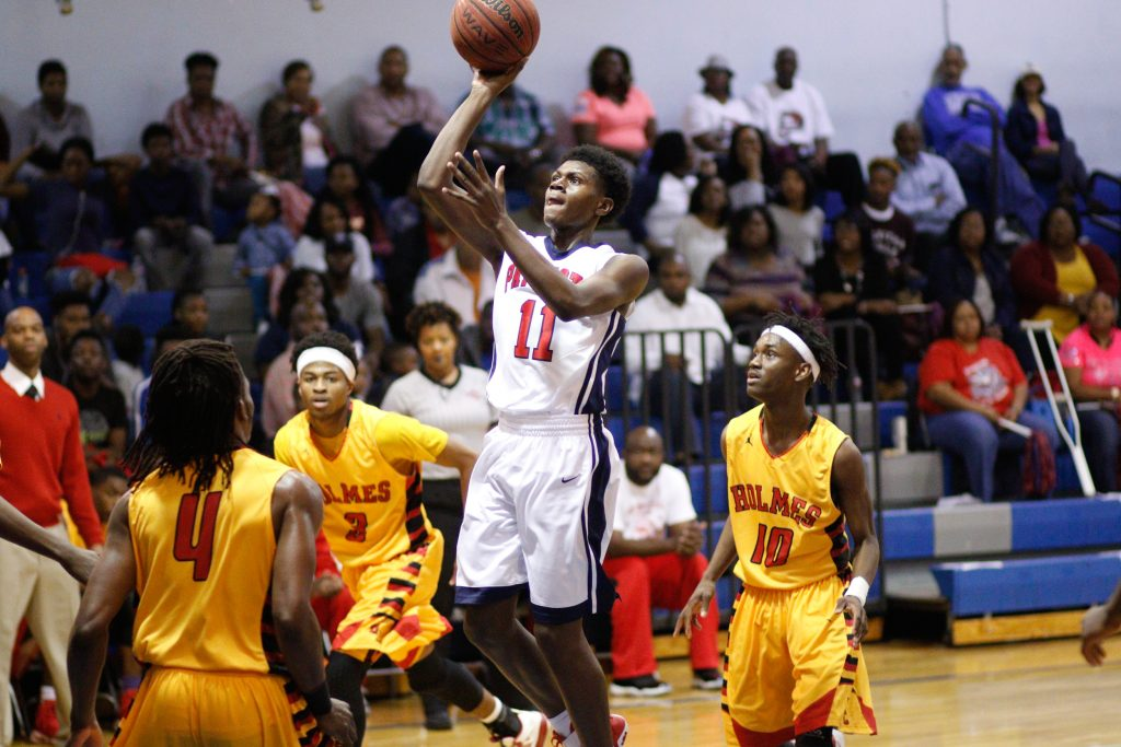 Marc Evans of Forest Hill shoots a floater