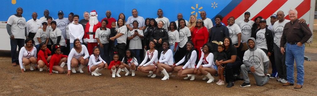 Members of the MS Retired Players Association and volunteers at the Christmas Annual Celebrity Bike Give Away