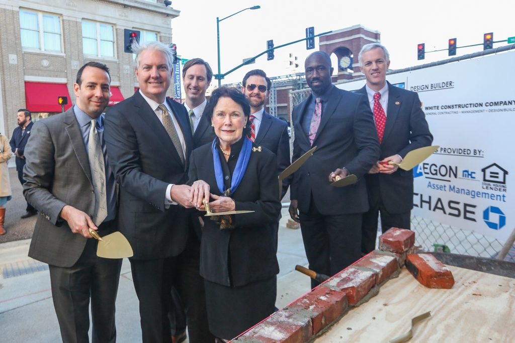 Officials at brick-laying ceremony.