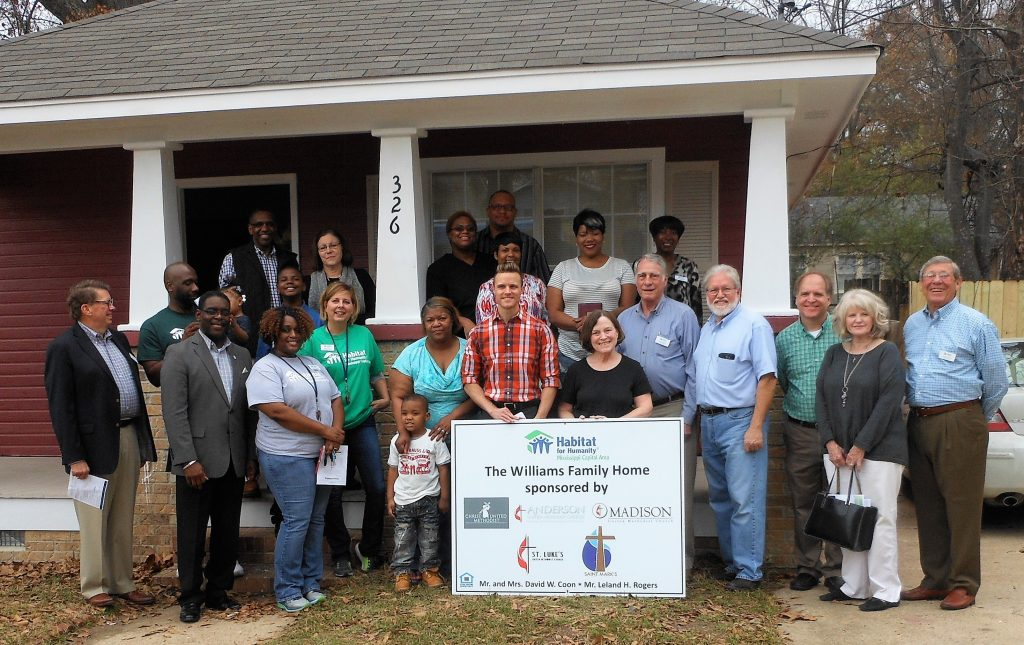 Habitat for Humanity board members, staff and volunteers dedicated the new home of Lequoya Williams on Manship Street Monday.
