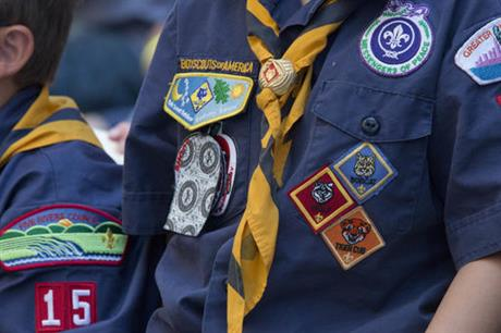 In this June 25, 2016, file photo, Cub Scouts watch a race during the Second Annual World Championship Pinewood Derby in New York's Times Square. The Boy Scouts of America announced Monday, June 25, 2016, that it will allow transgender children who identify as boys to enroll in its boys only programs. (AP Photo/Mary Altaffer, File)