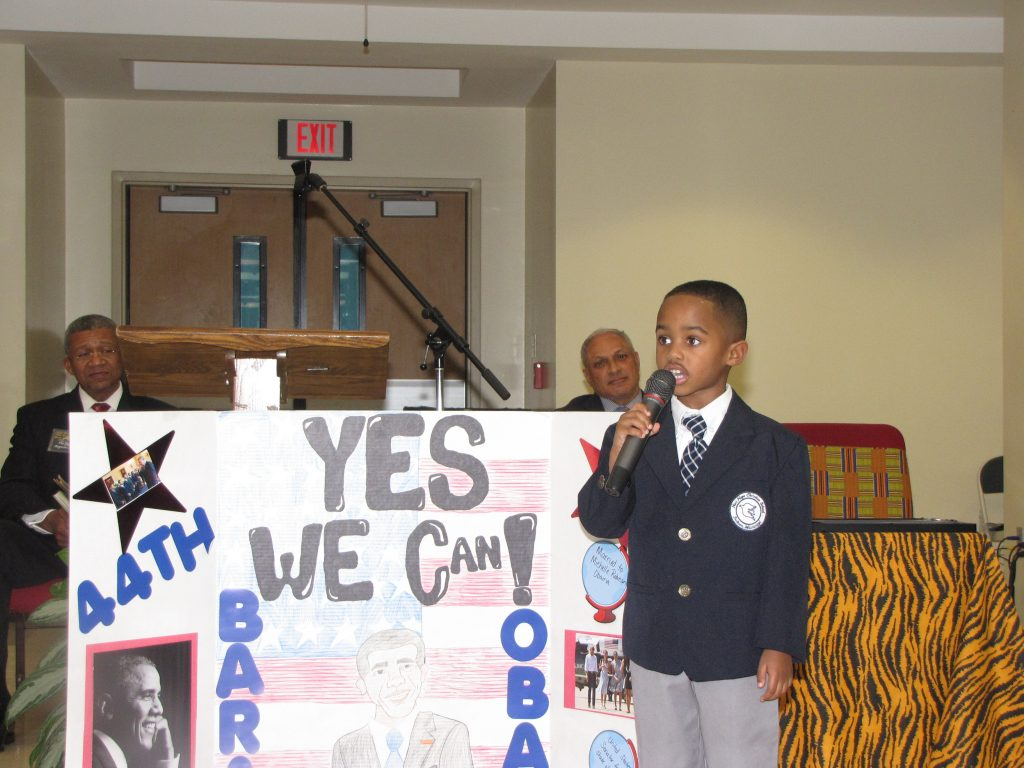 """New Hope Christian School boy reminds audience of President Barack Obama's """"Yes We Can"""" appeal for a better America."""