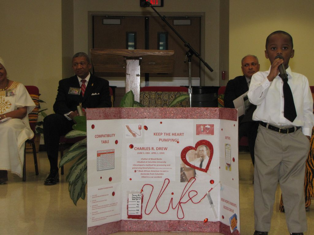 New Hope Christian School boy shares knowledge of Dr. Charles Drew and blood plasma.