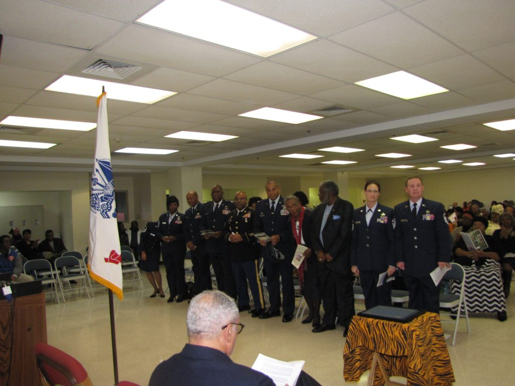 Standing: The Mississippi Air National Guard, special invited guests for the evening.