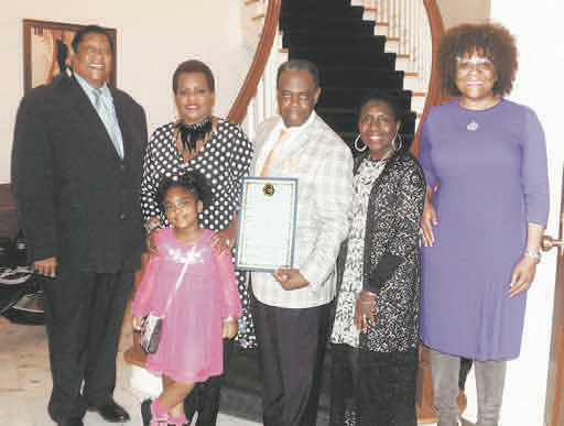 Jay Johnson (center) with Councilman Kenneth Stokes (left), family and friends