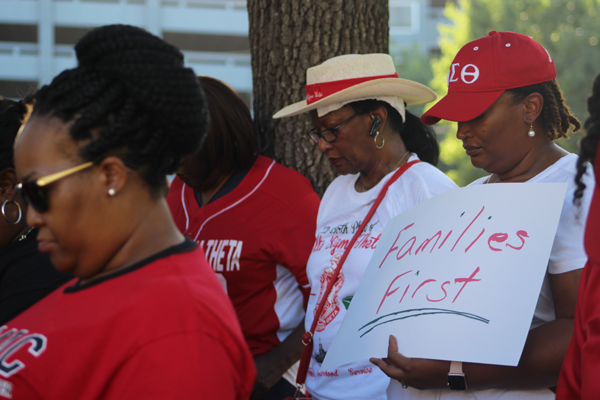 Members of Delta Sigma Theta Sorority, Inc. join in prayer to keep immigrant families united and safe as they seek refuge in the United States