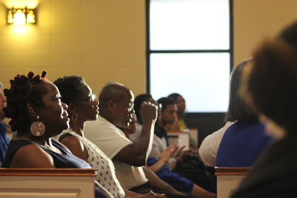 Attendees listen to testimonies from members of the Poor People's Campaign.