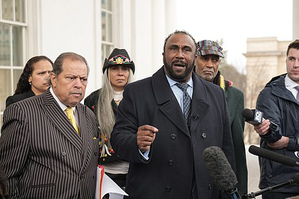 """John W. Boyd, president of the National Black Farmers Association, urges Gov. Northam to stay in office Monday at a Capitol news conference. With him, from left, are Richmond City Treasurer Nichole Armstead, former Richmond City Councilman Henry W. """"Chuck"""" Richardson, American Indian Farmers and National Women Farmers' Association President Kara Boyd and the Rev. Rodney Hunter, president of the Richmond Chapter of the Southern Christian Leadership Conference. PHOTO: Ava Reaves/Richmond Free Press"""