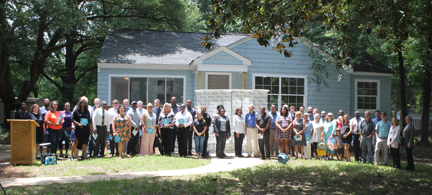 Representatives from churches, businesses, schools and government gathered with Habitat for Humanity supporters and staff June 27 to dedicate the first two houses rehabbed as part of the non-profit's new Broadmoor Initiative. The goal is to rehab and build 100 houses in 5 years.