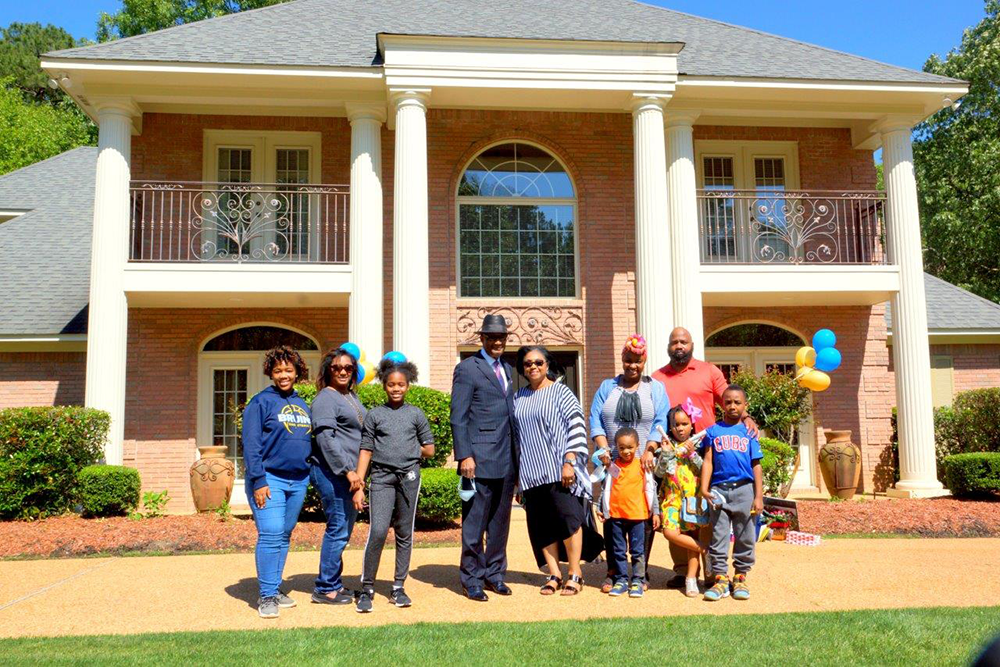 New Hope Pastor Jerry Young and First Lady Helen Young outside of their home on the day of the surprise parade, April 26, surrounded by family. PHOTO BY JAY JOHNSON