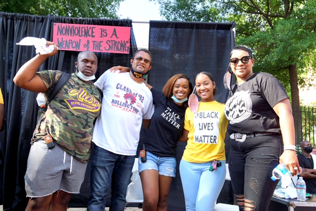 Calvert White (left) pictured with Maisie Brown (center in blue) and 81st Miss JSU Daisia Davis (in yellow), as well as other protesters