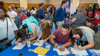 Photo of MTSU students explore part-time job opportunities at fair