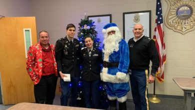 Photo of JROTC donates $1,000 to Police Department for holiday traffic stops