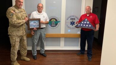 Photo of Tennessee Army National Guard SFC Tracy Banta Presents Flag to Rutherford County EMS for Supporting Flight Paramedics
