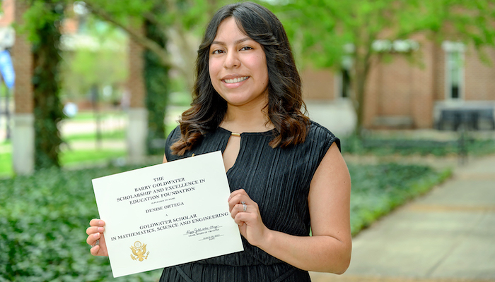 Ortega holds Goldwater certificate