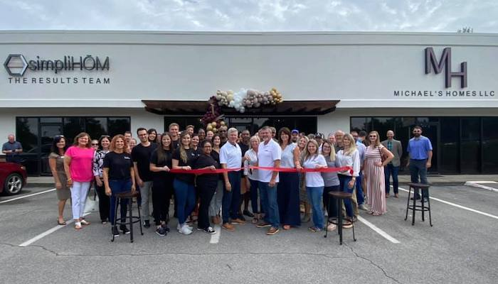 Ribbon Cutting for Michael's Homes