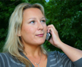 Woman talking on a cellphone. The EMR Network provides safety information for these devices!