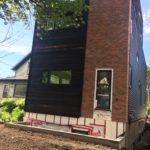 Planking and Faux Brick exterior finish on Polycore by S I Construction full home infill project