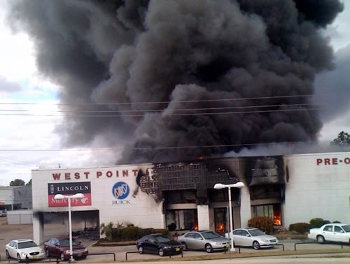 Car Dealership on fire