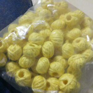 Light yellow cotton thread beads