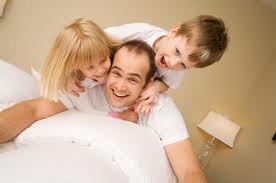 Dad and kids playing, having fun