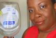 Joyce Brewer Holding Upside Down SoftSoap Bottle