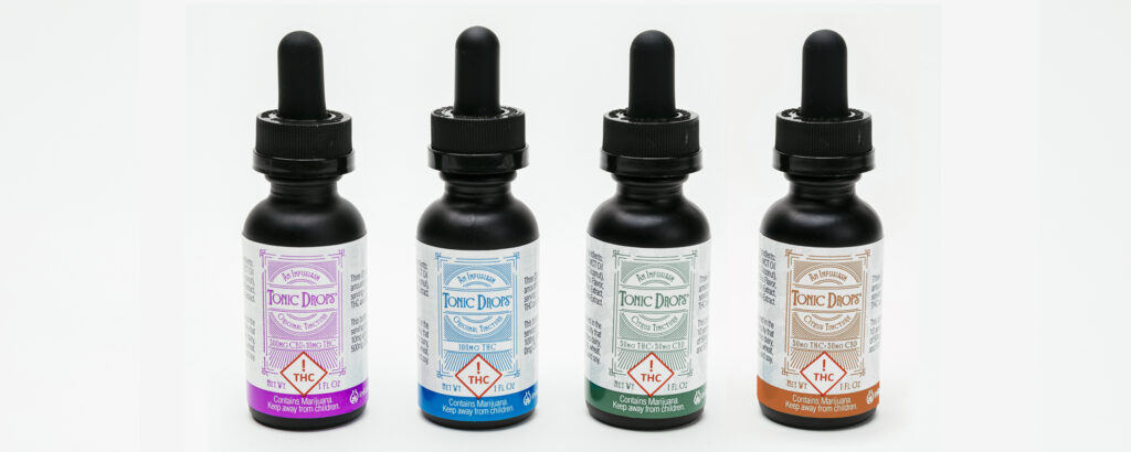 All four types of Infusiasm's Tonic Drops Tinctures; 20:1 CBD, THC, 50:1 CBD, 1:1 CBD sitting in a row