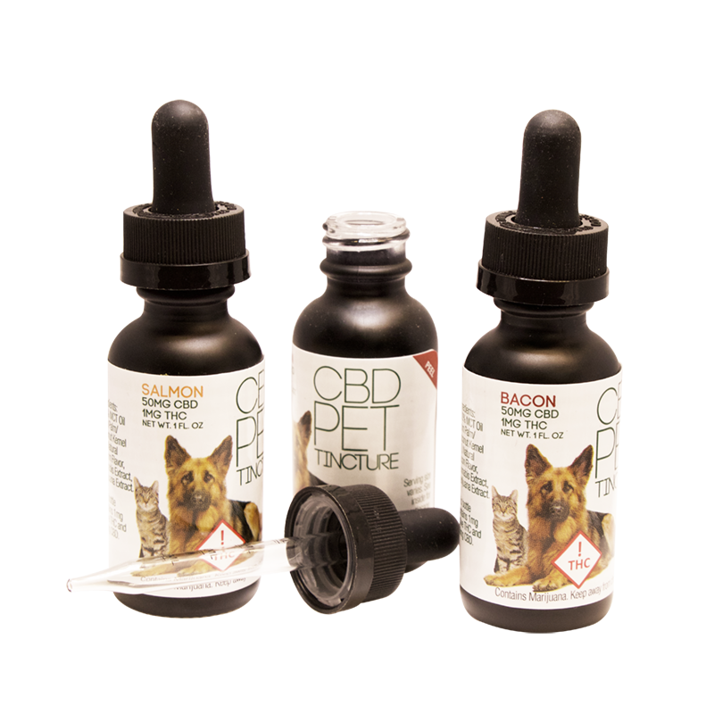 Three bottles of CBD pet tincture-  one of each flavor; bacon, salmon, and chicken