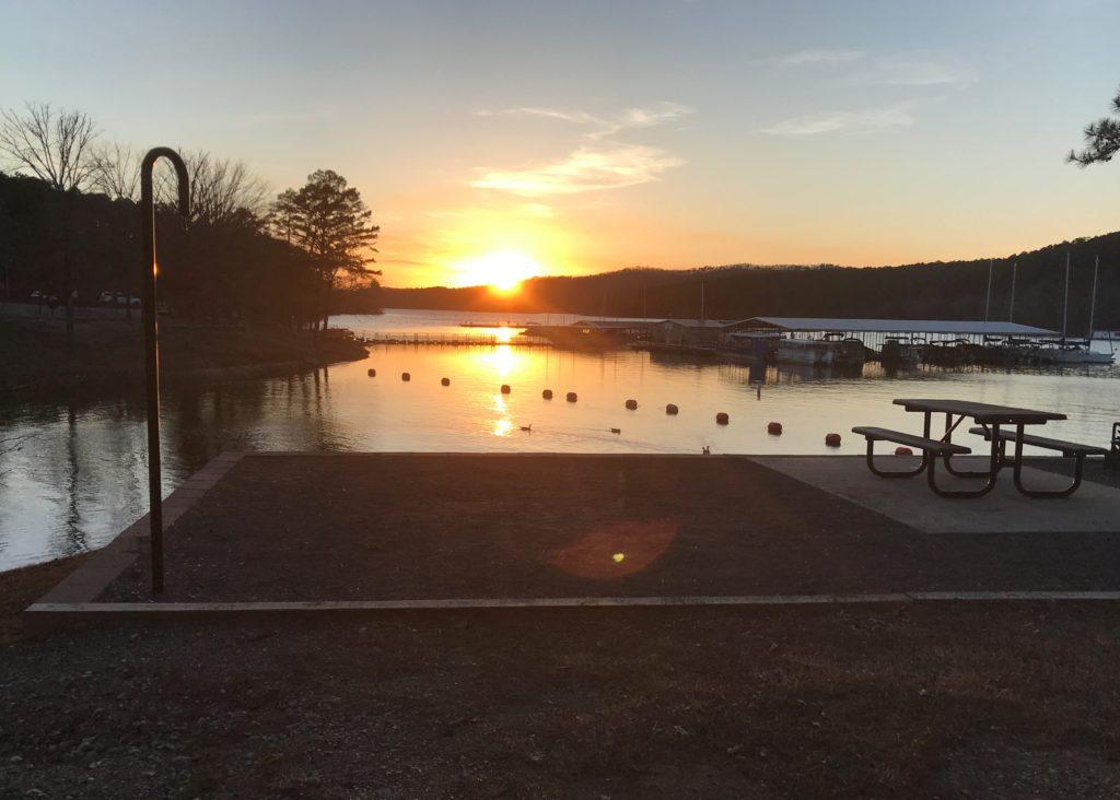 the sun setting over the marina at Lake Ouachita State Park