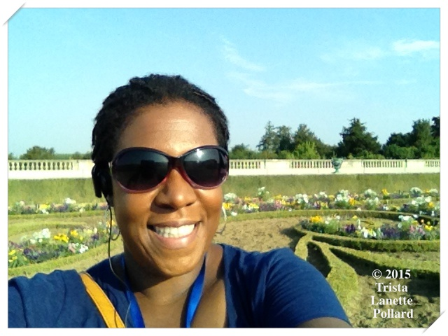The writer overlooking the Gardens of Versailles in France