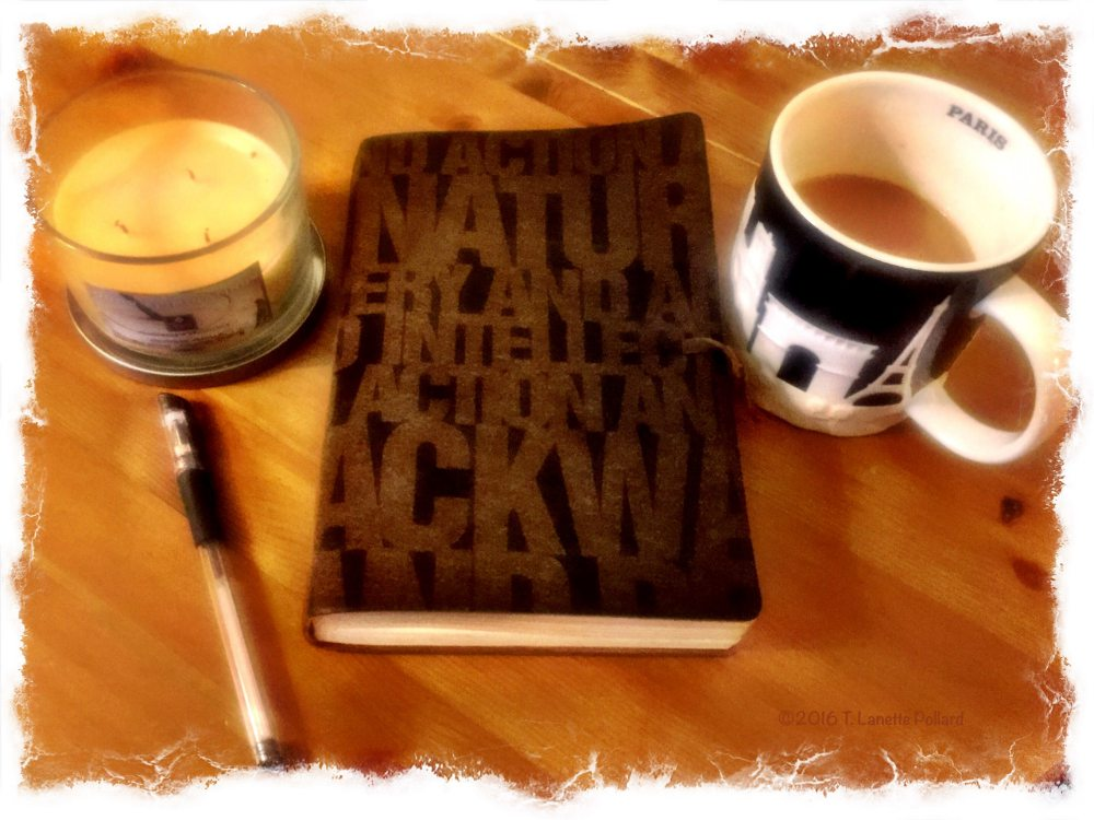 My writing journal, pen, candle, and coffee