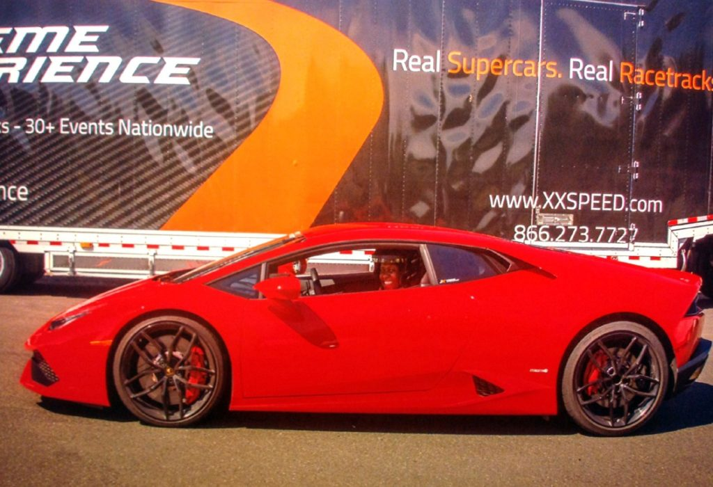 Me in a red Lamborghini after driving at least five laps.