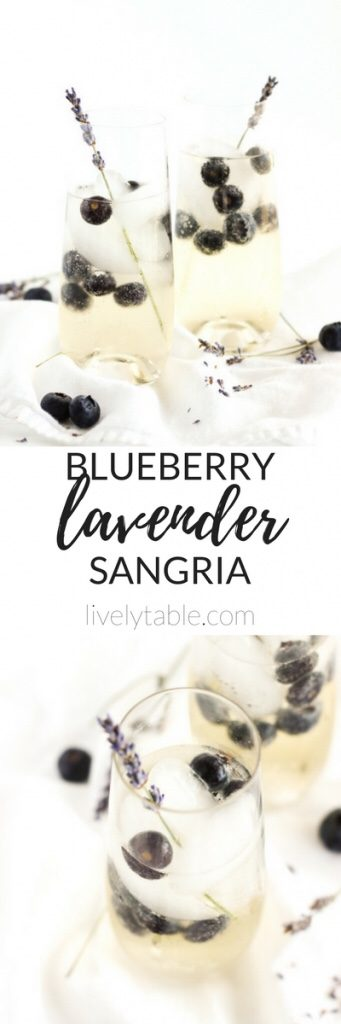 Blueberry Lavender Sangria in a pitcher with ice cubes and whole blueberries