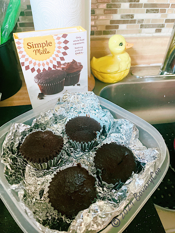 Chocolate chocolate chip muffins in a container