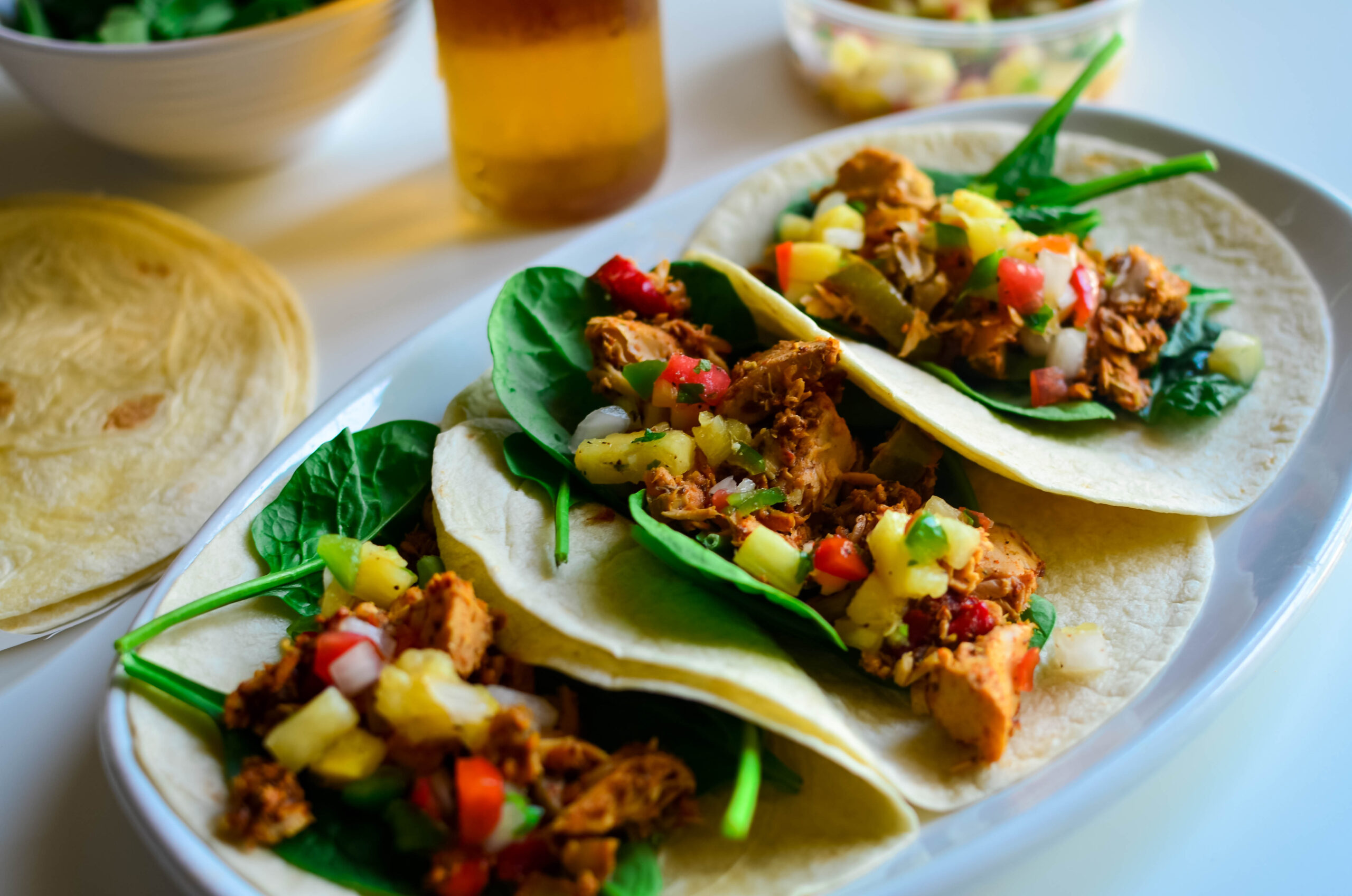 Salmon taco topped with Pineapple salsa