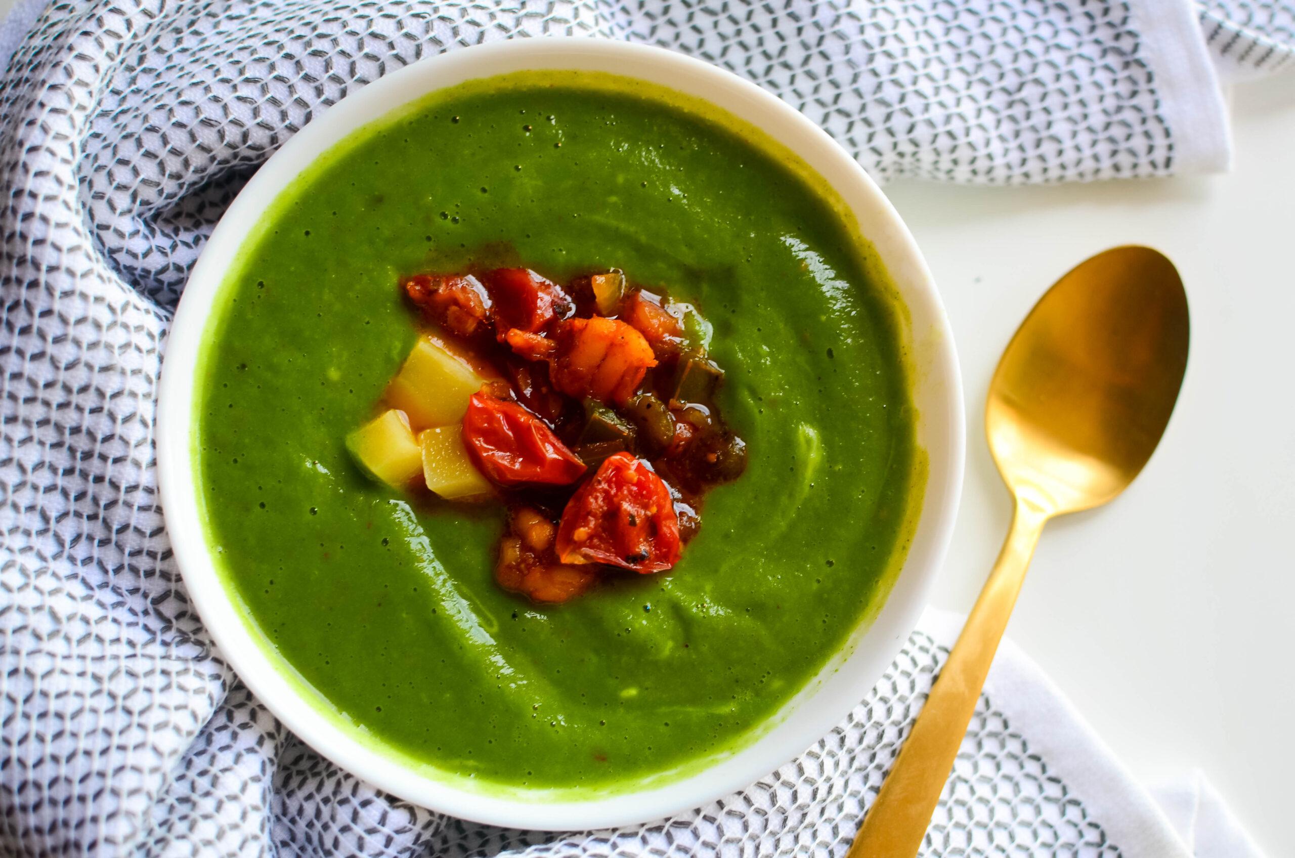 A delicious bowl of broccoi soup with a shrimp confit