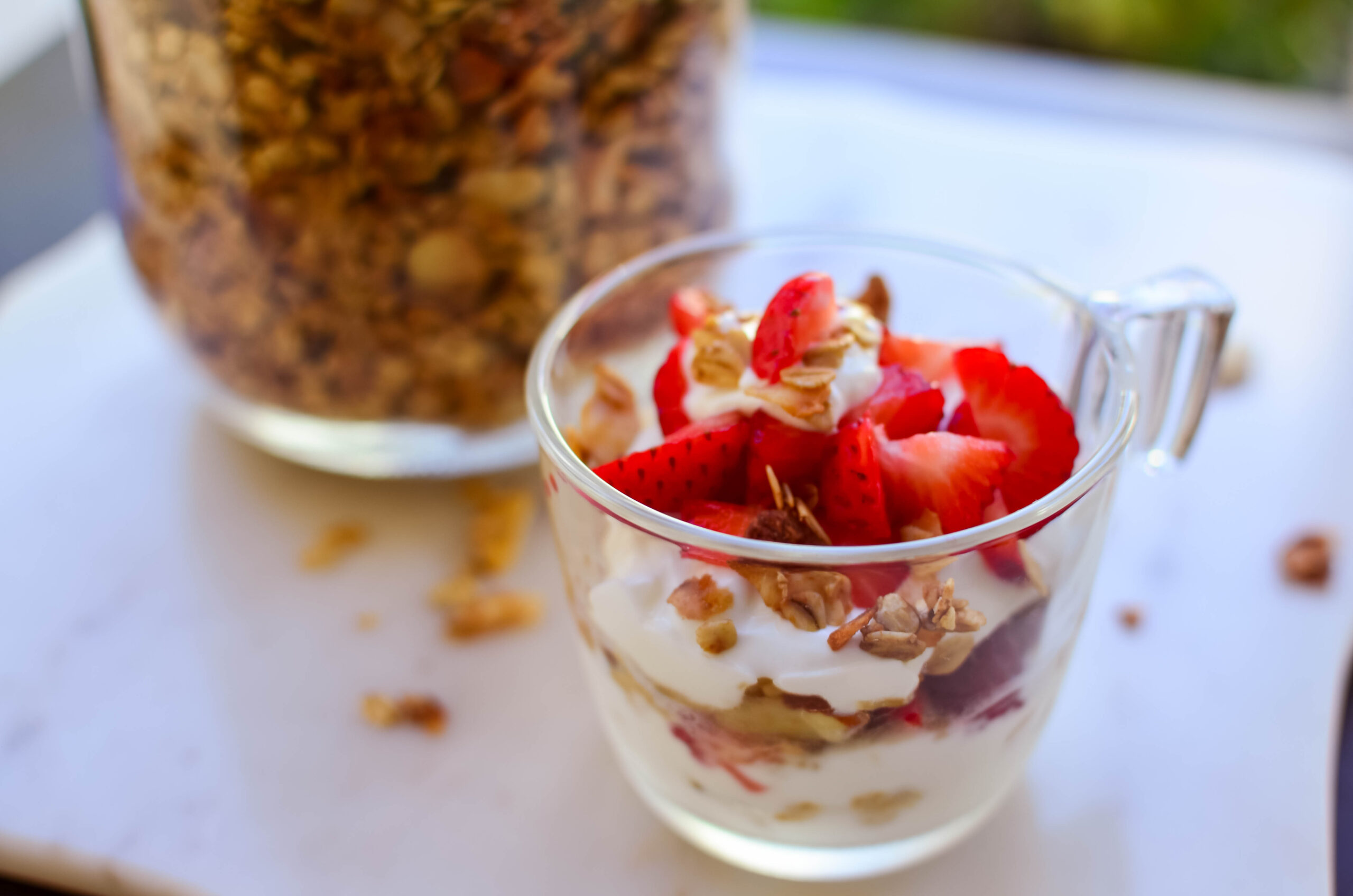 Budget friendly Coconut Vanilla Almond Granola parfait with more granola to shareola