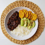Haitian White Rice black beans sauce and fried plantains bowl