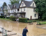 Residents Cleaning Up After Flooding